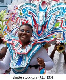 NASSAU, THE BAHAMAS - JANUARY 1 - Smiling, dancing group leader in brightly colored costume, performs in Junkanoo, a traditional island cultural festival in Nassau, The Bahamas on Jan 1, 2011.