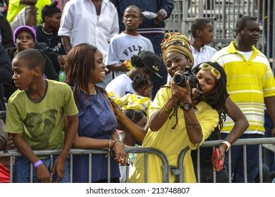 NASSAU, THE BAHAMAS - JANUARY 1: Spectators at Junkanoo Festival on January 1st 2014 in Nassau, the Bahamas