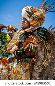 NASSAU, THE BAHAMAS - JANUARY 1 - Sultan clad dancer dressed in bright orange and brown feathers, performs in Junkanoo, a traditional island cultural festival in Nassau, Jan 1, 2011