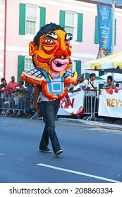 NASSAU, THE BAHAMAS - July 6 - Dancing man in colorful costume, performs in a traditional island cultural festival in Nassau, July 6, 2014