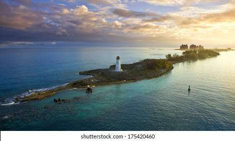 nassau bahamas, lighthouse, and paradise island at dawn