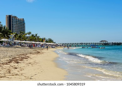 Nassau, Bahamas - March 1, 2018:  Tourists enjoying their vacation on the beach in Nassau, Bahamas.