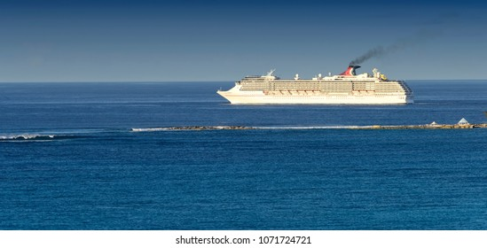 Nassau, Bahamas - March 1, 2018:  The Carnival Pride cruise ship departing from the Port of Nassau in the Bahamas, as it sails on the Caribbean Sea to it's next destination.