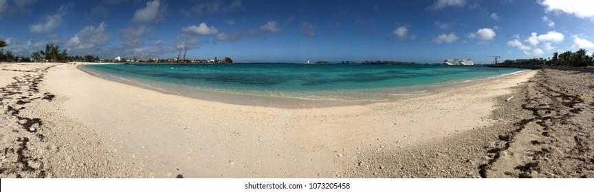 NASSAU, BAHAMAS-JANUARY 2018:  Panoramic scenic coastline of Nassau, Bahamas with a lighthouse and cruise ships docked in the harbor.