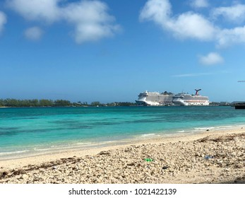 NASSAU, BAHAMAS--JANUARY 2018: Two luxury cruise ships are docked at the bay in Nassau on a bright sunny day seen from Junkanoo Beach Resort.