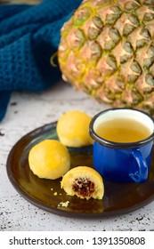 Nastar, Indonesian pineapple tart cookies  served with tea. Popular cookies during Idul Fitri or Lebaran or Eid Mubarak