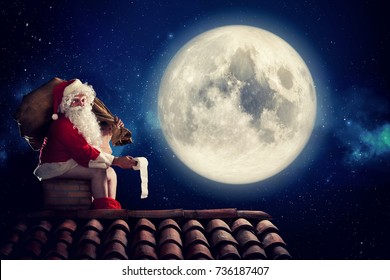Nasty Santa Claus poop in a chimney under moonlight as bad children gift. Alternative Christmas holiday greetings post card