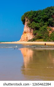 NATAL, BRAZIL - 11 October, 2018: Beautiful reflection of the cliff in the bay of the dolphins beach of the kite natal rio grande do norte