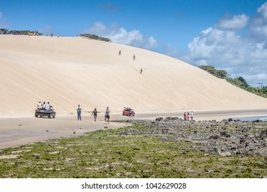 NATAL, RIO GRANDE DO NORTE, BRAZIL - AGO 4, 2017: People walking in the coast under sand dunes