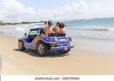 Natal / Rio Grande do Norte / Brazil - Circa May 2019: Image of buggy car in the sands of Natal, Rio Grande do Norte, Brazil.