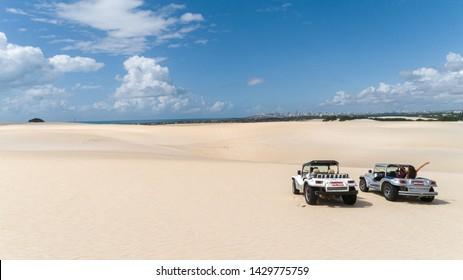 Natal / Rio Grande do Norte / Brazil - Circa May 2019: Image of buggy cars in the sands of Natal, Rio Grande do Norte, Brazil.