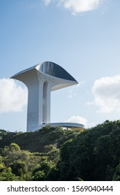 Natal, Rio Grande do Norte, Brazil: September 8, 2017: The Central Tower at the Natal City Park designed by Brazilian architect Oscar Niemeyer, with an oval museum on top and a curved ramp entrance.