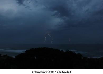 Natal South Africa - DECEMBER Two Lightning strikes onto Ocean