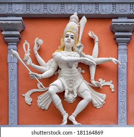 Nataraj Dancing Form of Lord Shiva Hindu God Orange and White Statue on Temple Exterior Wall Relief