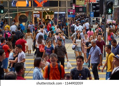 NATHAN ROAD, KOWLOON, HONG KONG - JULY 2018: Typical crowded street scene in busy Kowloon - pedestrians crossing the street.