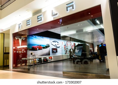 NATICK - JANUARY 25, 2014: Exterior view of a Tesla motors store in the mall on January 25, 2013 in Natick, USA. Tesla Motors produced the Tesla Roadster, the first fully electric sports car.