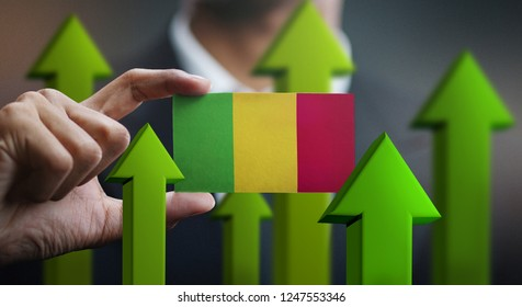 Nation Growth Concept, Green Up Arrows - Businessman Holding Card of Mali Flag