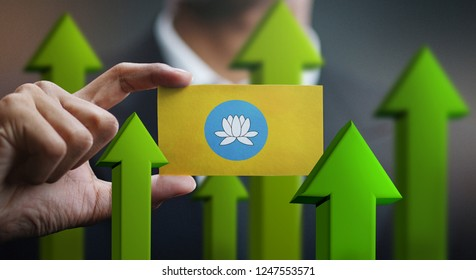 Nation Growth Concept, Green Up Arrows - Businessman Holding Card of Kalmykia Flag