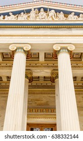 National Academy of Athens, Greece. Focus on the details of the front columns. Greek art on the marble pillars.