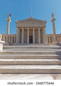 national academy of Athens Greece, main facade with classical columns and Parthenon styled pediment