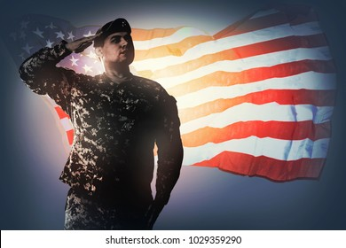 National Anthem is played. Army Ranger from Special Troops Battalion in universal Camouflage pattern Uniforms and beret is standing in attention and saluting proudly with honor and respect.