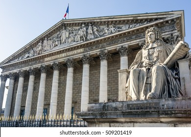 National Assembly and status Aguesseau. Paris FRANCE - November 2, 2016. The Palais Bourbon is the name commonly given to the building that houses the French National Assembly