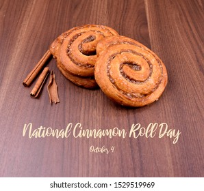 National Cinnamon Roll Day images. Cinnamon roll on a wooden background stock images. Cinnamon roll with spices. Sweet pastry stock images. Favorite Scandinavian pastry. Delicious cinnamon bun.