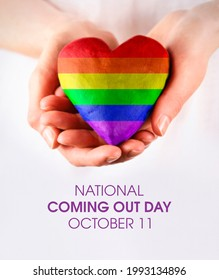 National Coming Out Day stock images. Rainbow LGBT pride flag in heart shape stock images. Female hands giving rainbow heart stock photo. Coming Out Day Poster, October 11. Important day - Shutterstock ID 1993134896