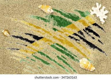 National country flag of Jamaica under a beach background with sand, sea shells and coral
