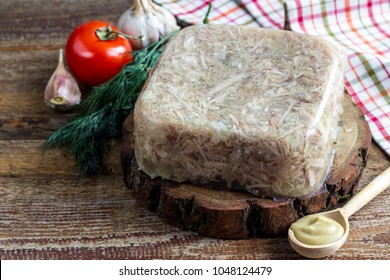 National cuisine. Russian traditional dish - Holodets. Homemade jellied meat with garlic and spices garnished with mustard. Selective focus