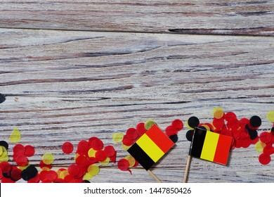national day of Belgium , July 21. national Belgian festival. the concept of celebration, fun, patriotism and freedom. mini flags and confetti on white wooden background. horizontal pfoto