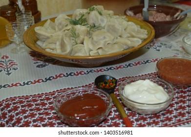national dish Mari dumplings with sour cream