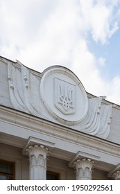 national emblem of ukraine on the facade of the parliament building. trident - national symbol of Ukraine on the building of parliament, vertical image