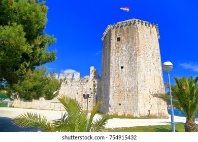 National flag above medieval fortress located on the Adriatic sea shore in Trogir, Croatia