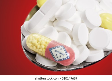 The national flag of Arkansas on a capsule and pills on a spoon.(series)