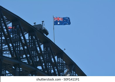 The National flag of Australia blows on Sydney Harbour Bridge in Sydney New South Wales,  Australia.