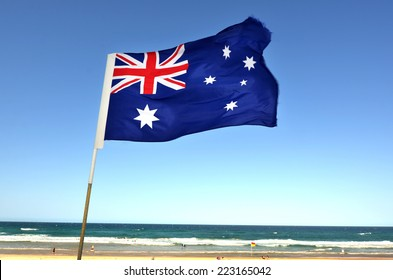 The National flag of Australia flay over the Gold Coast in Queensland, Australia.