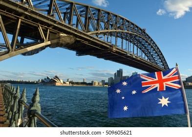 The National flag of Australia flies under Sydney Harbor Bridge in Sydney, Australia