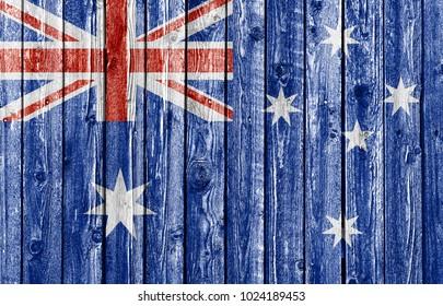 National flag of Australia on old weathered wood background