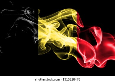 National flag of Belgium made from colored smoke isolated on black background. Abstract silky wave background
