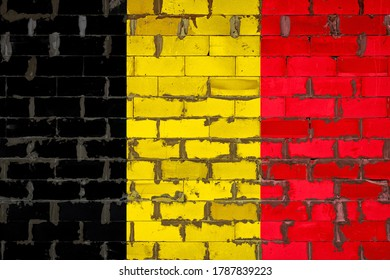 The national flag of Belgium painted on a wall of sibit blocks with cement . The symbol of the country.