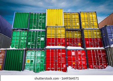 The national flag of Benin on a large number of metal containers for storing goods stacked in rows on top of each other. Conception of storage of goods by importers, exporters