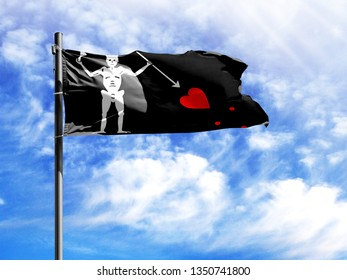 National flag of Blackbeard Pirate on a flagpole in front of blue sky.