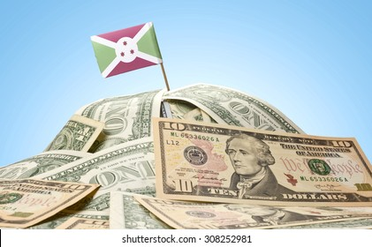 The national flag of Burundi sticking in a pile of american dollars.(series)
