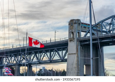 National Flag of Canada with Burrard Street Bridge in the background. Vancouver, British Columbia, Canada.