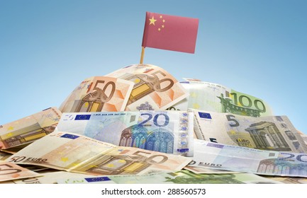 The national flag of China sticking in a pile of mixed european banknotes.(series)
