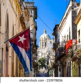 National flag from cuba with view of the capitol in cuba havana