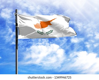 National flag of Cyprus on a flagpole in front of blue sky.