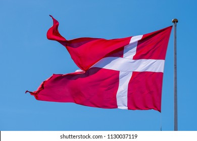 The national flag of Denmark called Dannebrog. The flag holds the world record of being the oldest continuously used national flag.