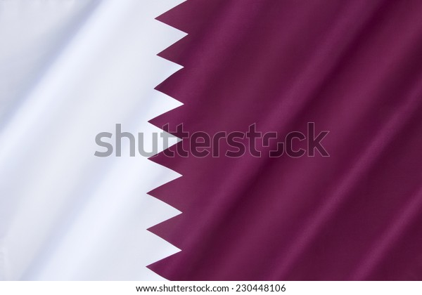 National flag and ensign of Qatar - The flag was officially adopted on July 9, 1971, although a nearly identical flag (only differing in proportion) had been used since 1949.